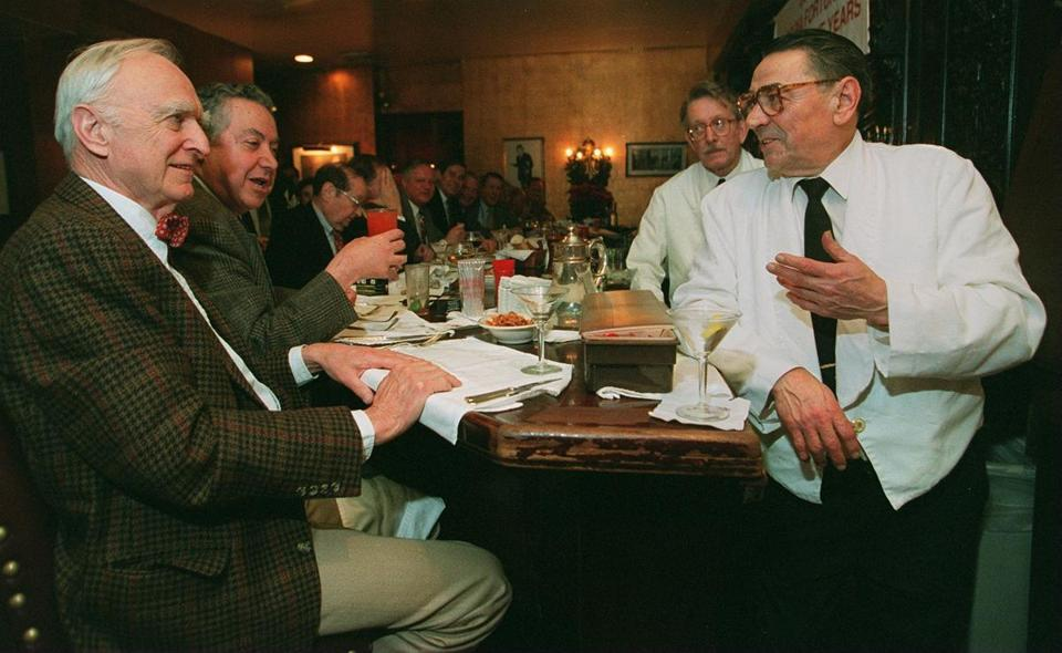 "Longtime Locke-Ober employee Alfredo ""Butch"" Bartolizzi, right, talks with Paul Christopher of Haverhill, left, at the bar in December 1996. In its heyday, the restaurant was a magnet for celebrities as well as local politicians and writers."