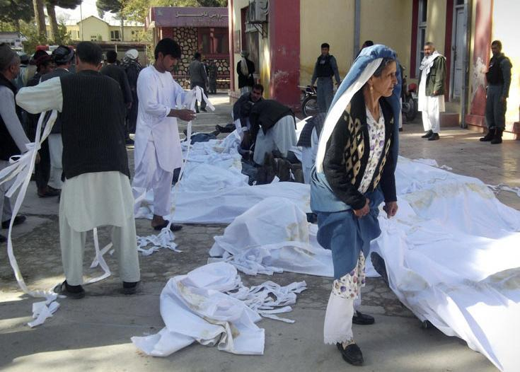 Bodies of bombing victims were placed in the courtyard of a hospital in Afghanistan on Friday. A suicide bomber blew himself up outside a mosque, killing dozens of people and wounding many more, government and hospital officials said.