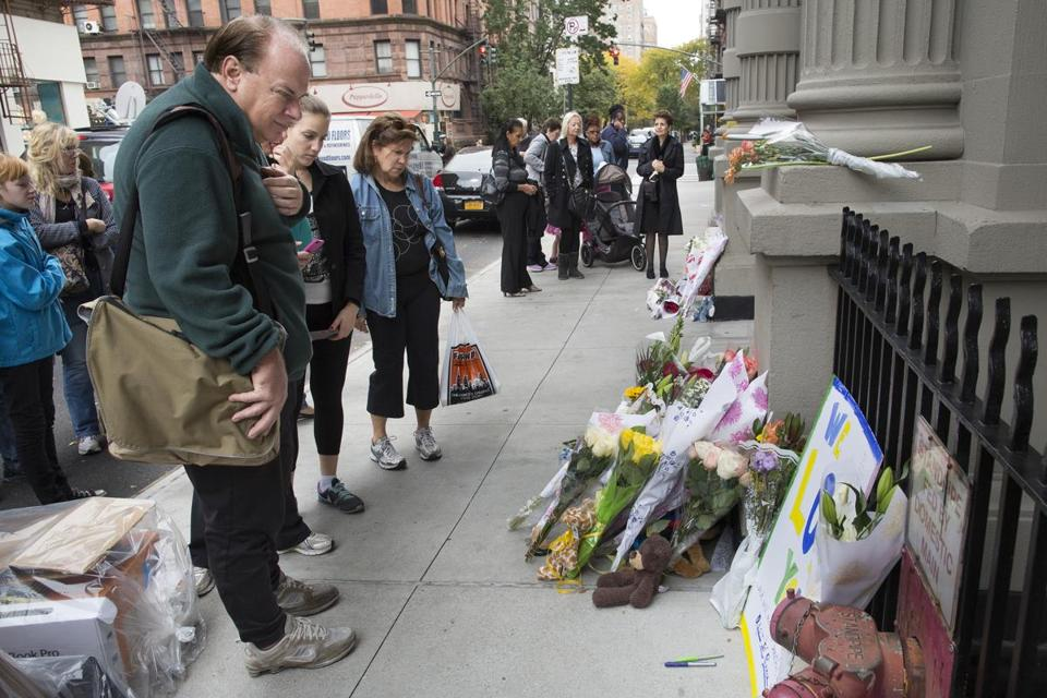 A makeshift memorial for two children stabbed to death, allegedly by their nanny, drew a crowd outside a building in New  York's Upper West Side on Friday. The children of a CNBC executive were found dead by their mother. The nanny was in critical condition with apparently self-inflicted injuries.