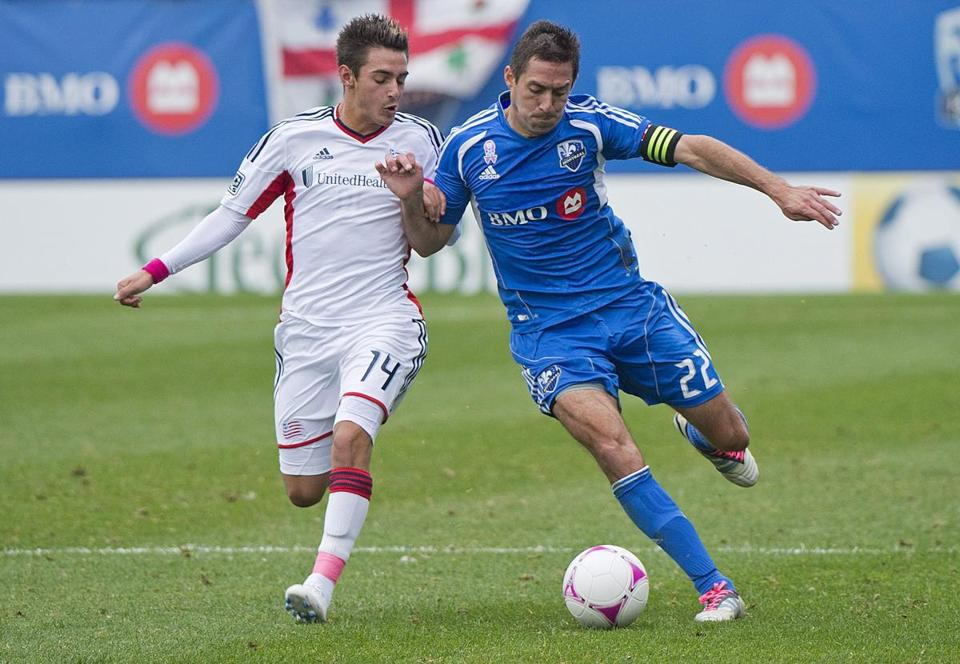 Diego Fagundez (left) of the Revolution and Montreal's Davy Arnaud battle for the ball.