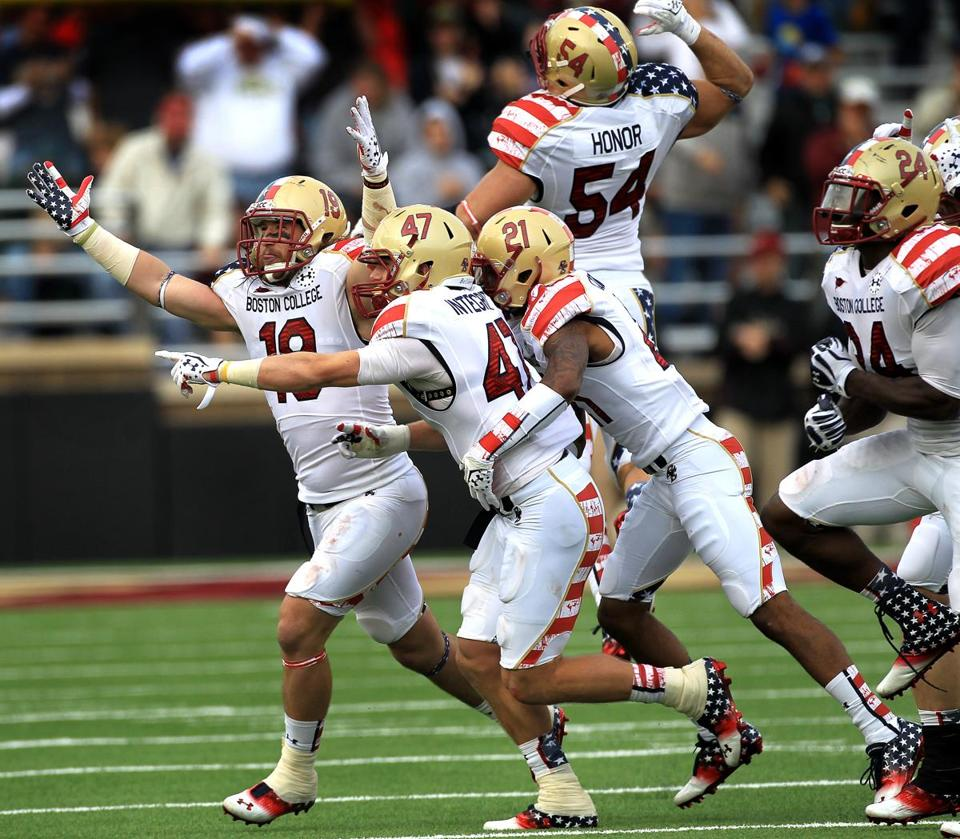 Wearing special star-spangled uniforms, the BC defense celebrates a game-sealing interception by Spenser Rositano (47).