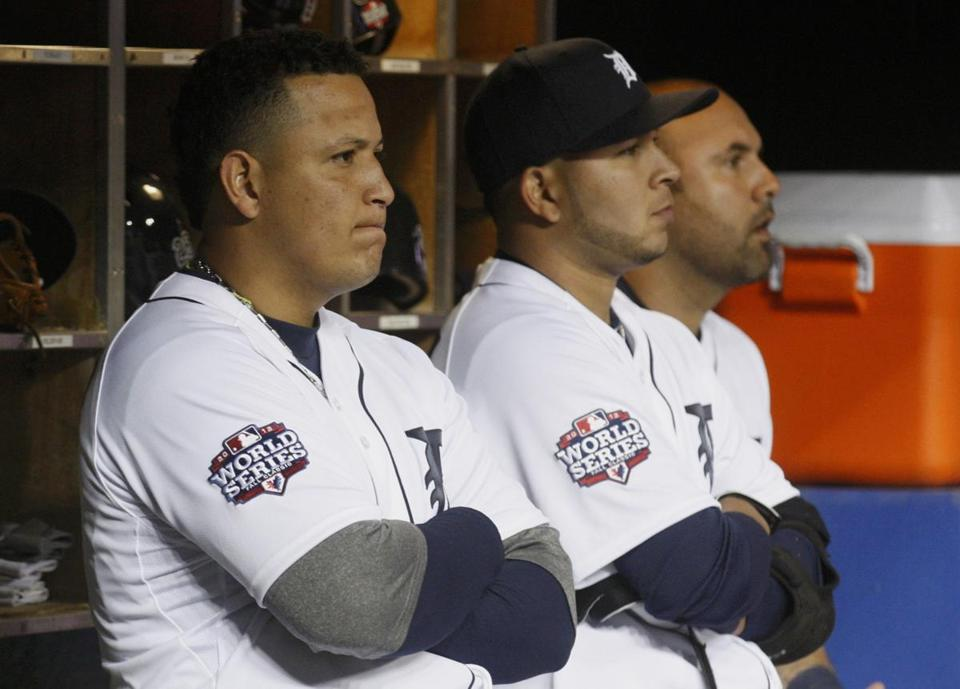 Miguel Cabrera, Jhonny Peralta, and Gerald Laird (left to right) watch the last outs.