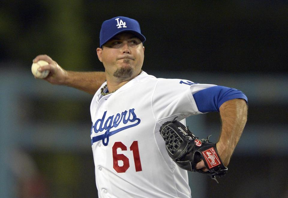 The Dodgers took on some $260 million in contracts by acquiring Josh Beckett (above), Carl Crawford, and Adrian Gonzalez from the Red Sox.