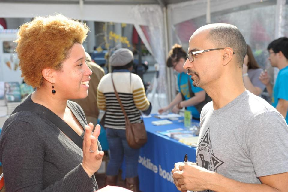 Author Junot Diaz (right) talks with a fan at the Boston Book Festival.