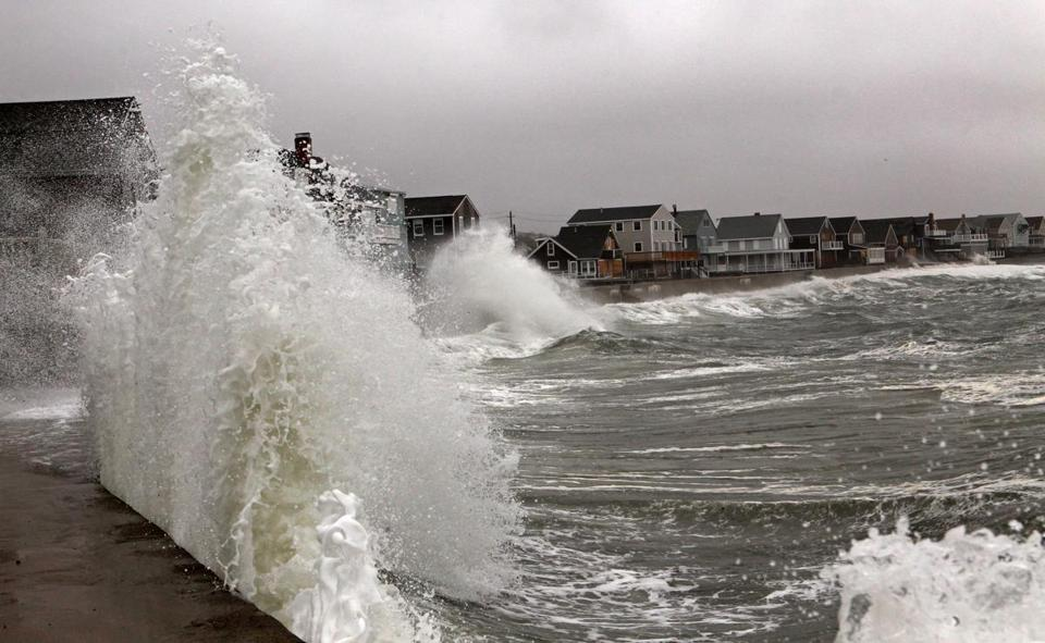 Waves slammed into a seawall in Scituate in October 2012.