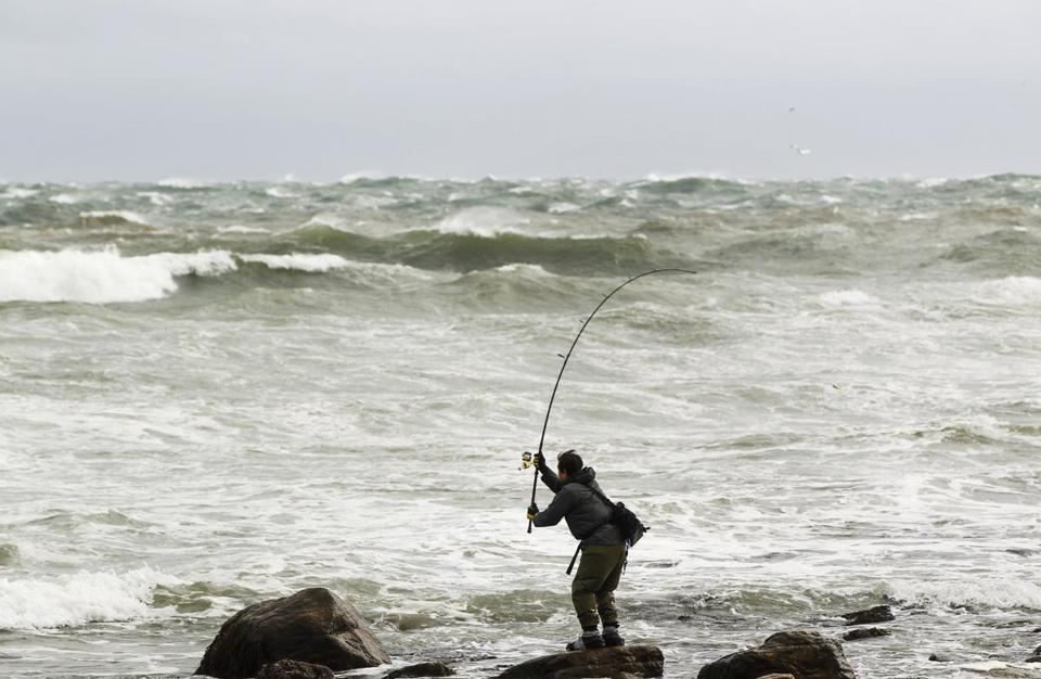 Turbulent waves didn't deter one fisherman in Montauk, N.Y., on Sunday. Hurricane Sandy could be one of the most fearsome storms to hit the US mainland when it comes ashore Monday night, bringing strong winds and dangerous flooding to the East Coast, from the mid-Atlantic states to New England.