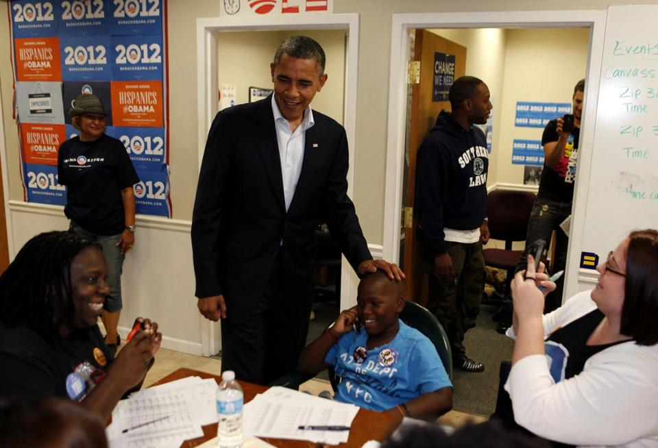 President Obama spoke with volunteers at his field office in Orlando Sunday. Obama spent part of the day focusing on preparations for a massive storm approaching the East Coast.