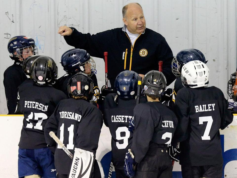 Bruins coach Claude Julien makes a point to an attentive Winthrop Squirt B team during its game vs. Watertown Sunday.