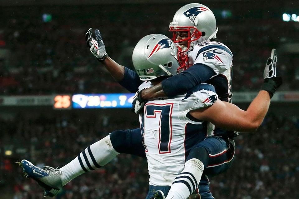 Brandon Lloyd leaps into the arms of teammate Nate Solder after his second touchdown catch of the game.