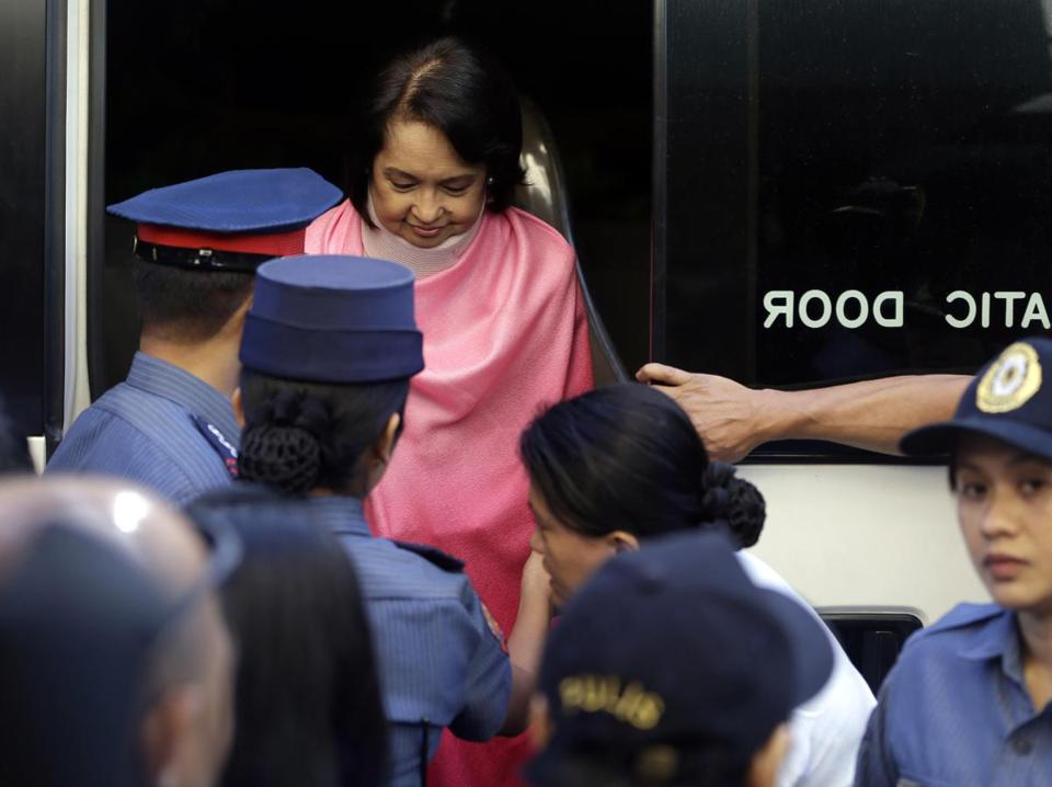 Former Philippine President Gloria Macapagal Arroyo, who is currently under hospital arrest, prepares to be wheeled into the courtroom of theAnti-graft Court on Monday. Arroyo is charged with plunder for allegedly misusing state lottery funds