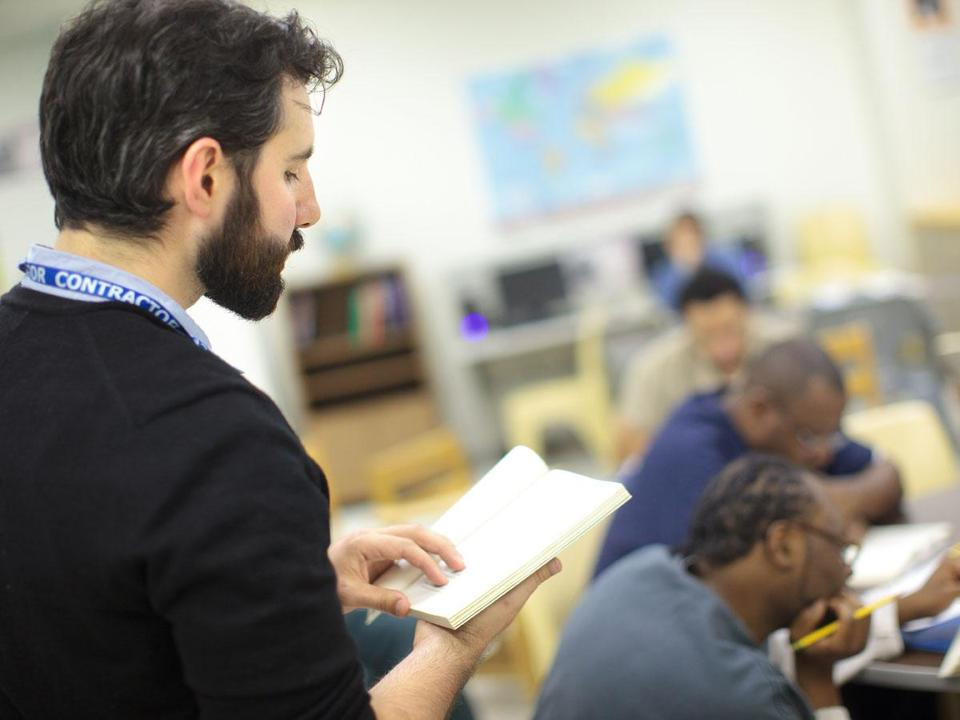 "Anthony D'Aries teaching his literacy class at the South Bay House of Correction. D'Aries this year published a memoir, ""The Language of Men,"" and with his father and these men he looks at their representation of manhood."