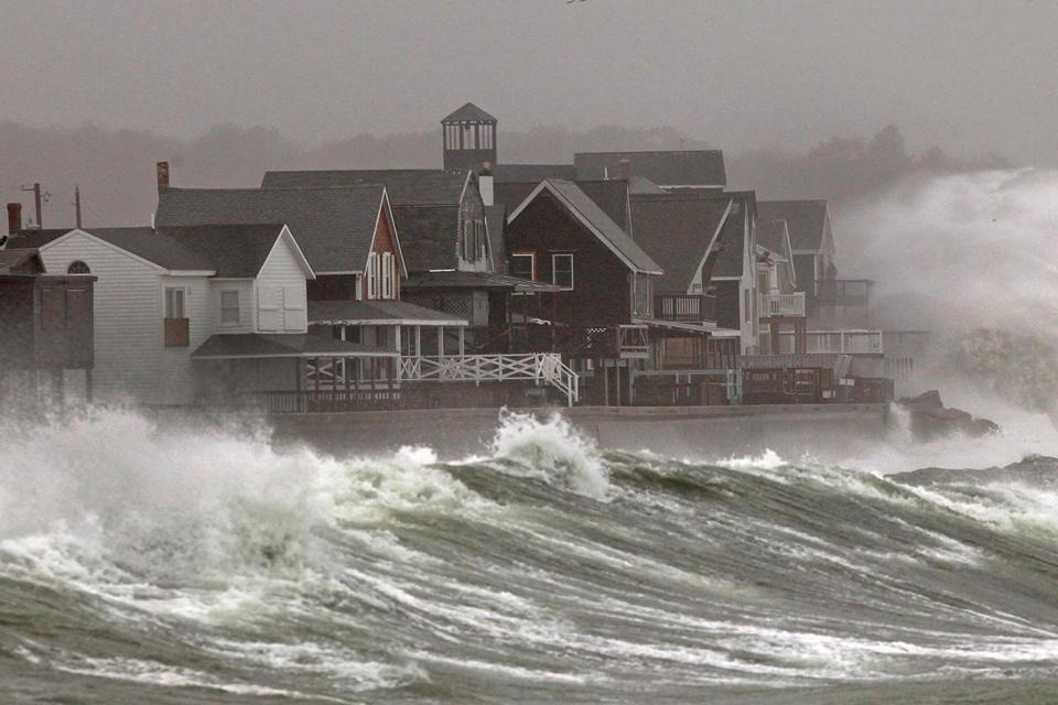 Waves crashed over homes on Turner Road in Scituate on Monday. Even though the landfall was in New Jersey, Massachusetts took a pounding from one of the biggest storms in history.