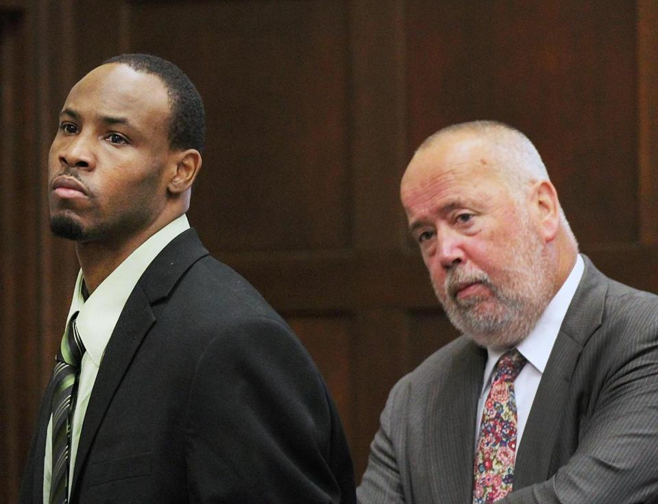Dwayne Moore (left) was in court Wednesday with his lawyer, John Amabile.