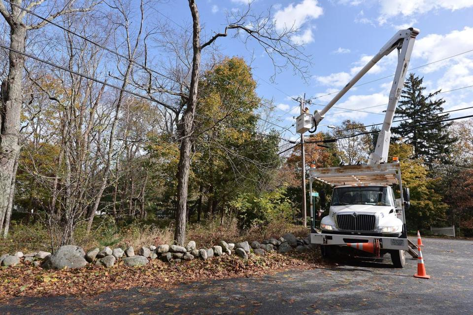 A National Grid crew works in Norwell Tuesday.
