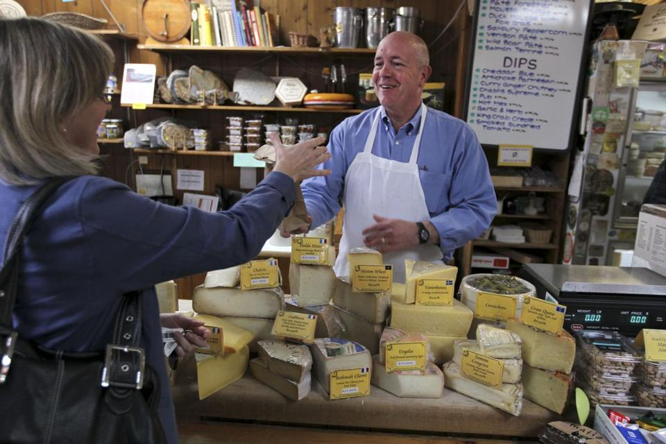 "Peter Lovis, who owns the Concord Cheese Shop, helped Connie McKelvey sample cheeses. ""Don't buy a cheese unless you can taste it first,"" he advises."