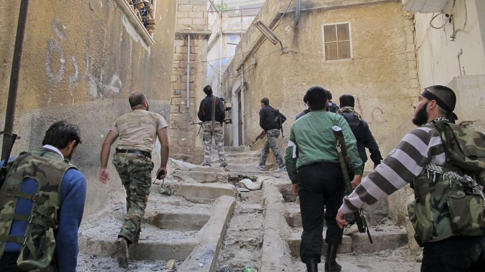 Members of the Free Syrian Army were on patrol in the town of Haram Tuesday.