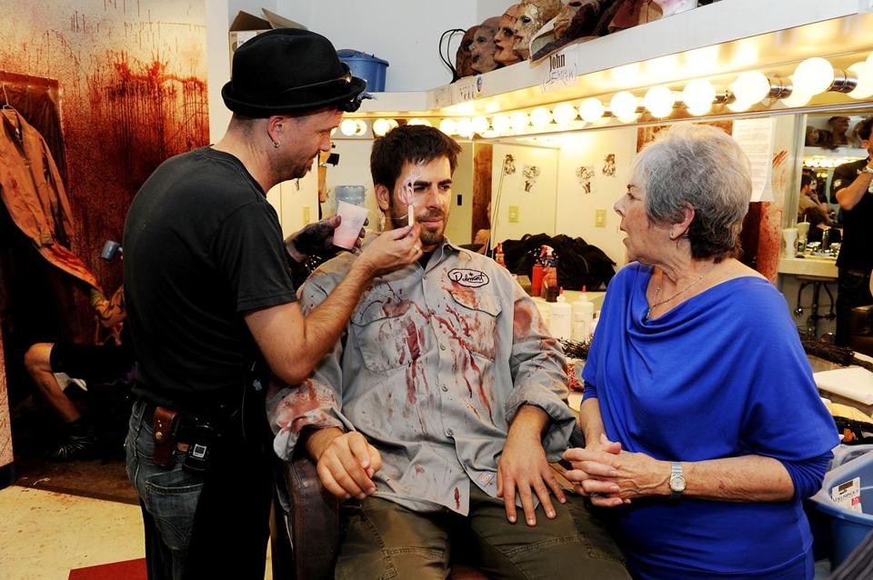 "Eli Roth (center) with his mother, Cora, in the dressing room getting in character for ""Goretorium."""