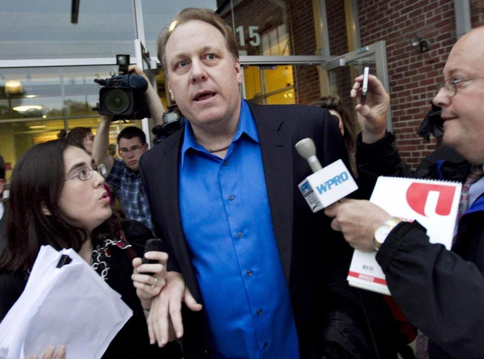 Former Boston Red Sox pitcher Curt Schilling, center, left the Rhode Island Economic Development Corporation headquarters in Providence after a meeting in May.