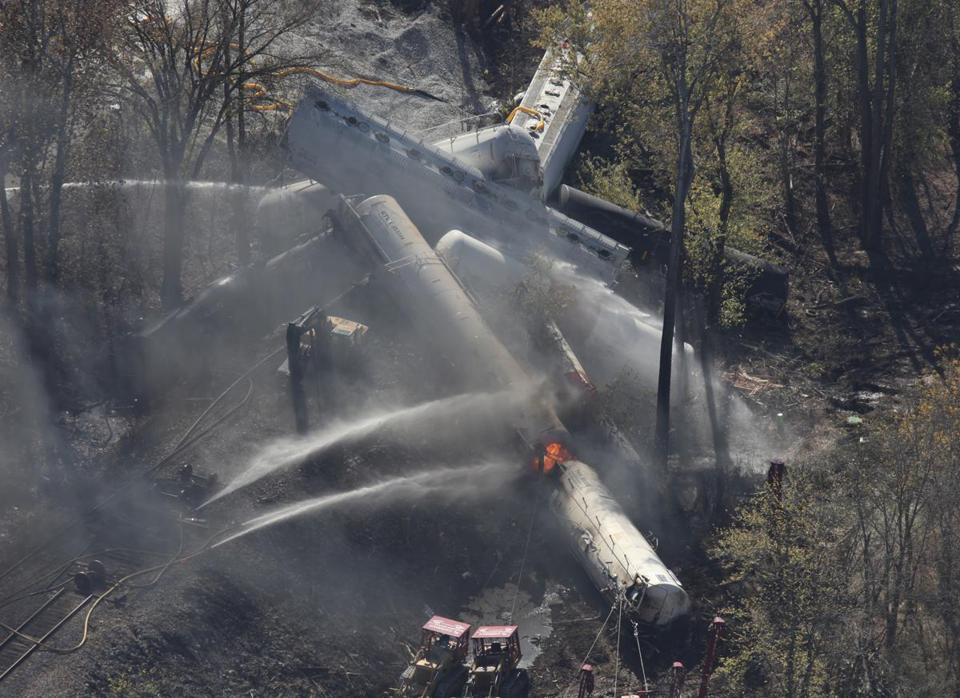 Three workers were severely burned Wednesday by flames at the site of a train derailment just south of Louisville, Ky.