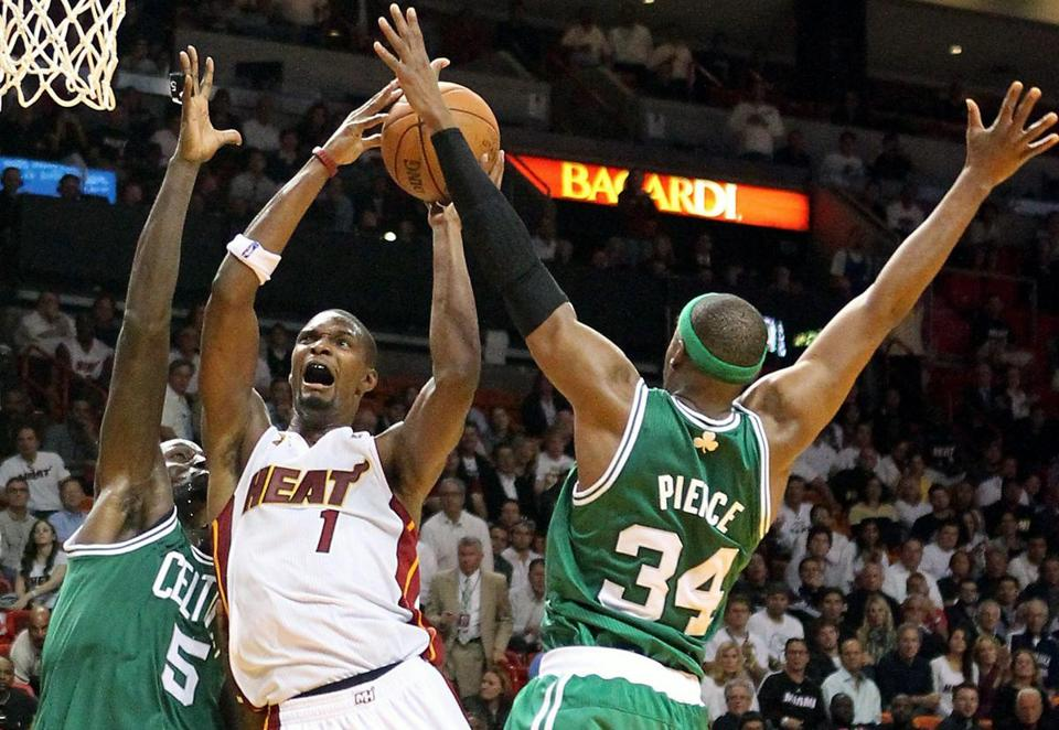 Miami's Chris Bosh is double-teamed by Kevin Garnett and Paul Pierce in Tuesday's game.