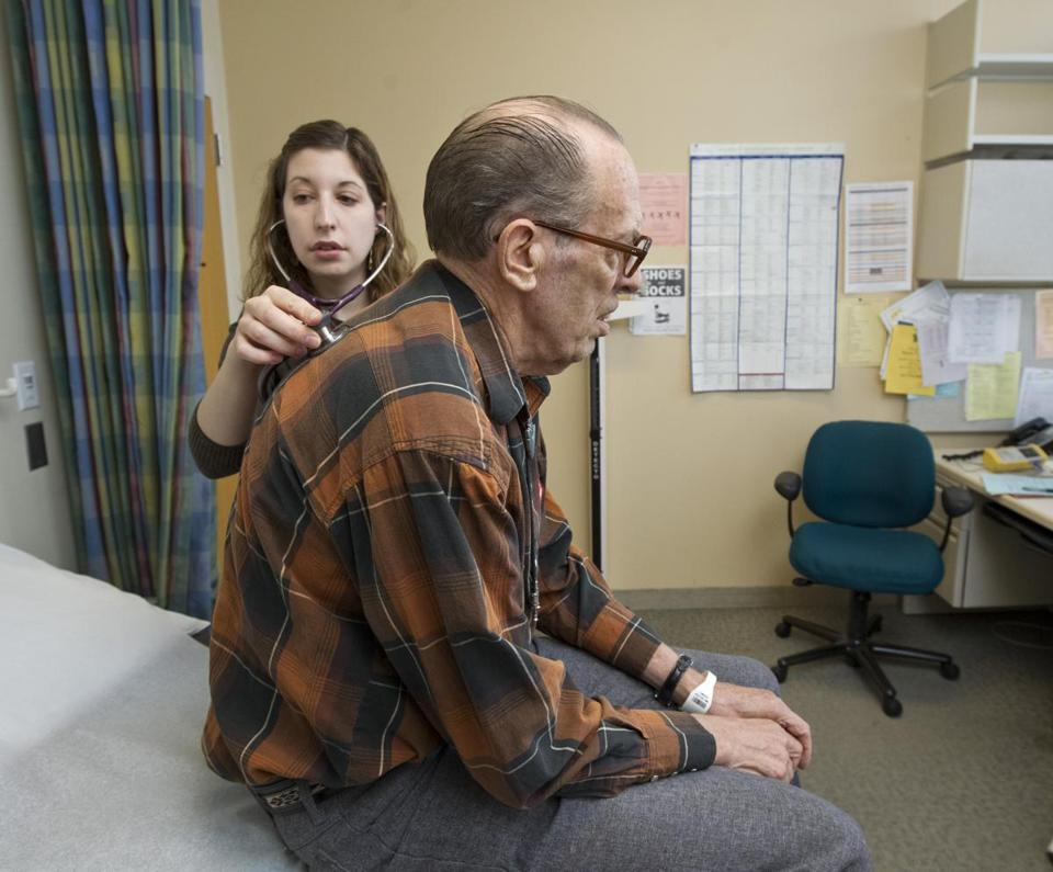 Dr. Elizabeth Brem checks Roger Jensen at Beth Israel Deaconess Medical Center. Diagnosed with lung cancer while hospitalized for pneumonia, Jensen participates in a program offering close follow-up care to Medicare patients at risk for frequent hospitalizations.