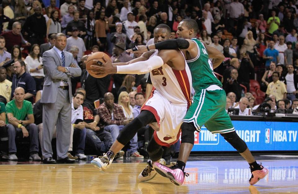 The Heat's Dwyane Wade was fouled by Rajon Rondo on this drive in the fourth quarter on Tuesday.