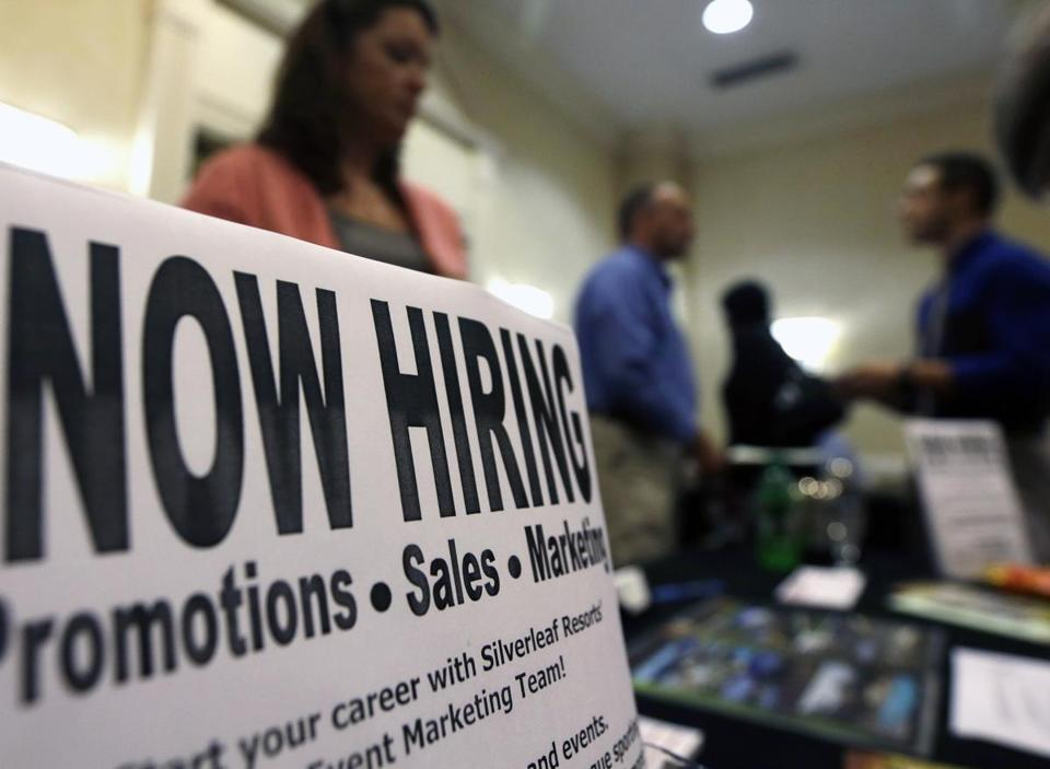 A sign at a job fair in Colonie, N.Y., last month. Companies are hiring steadily but cautiously, data show.