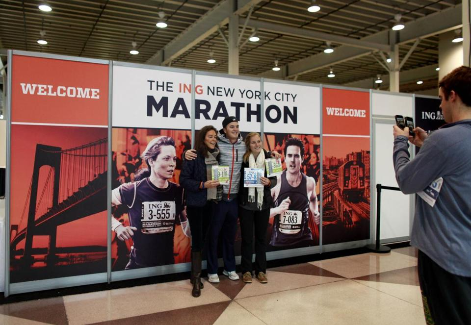 Some who'd hoped to run in the NewYork City Marathon pose in front of a race banner.