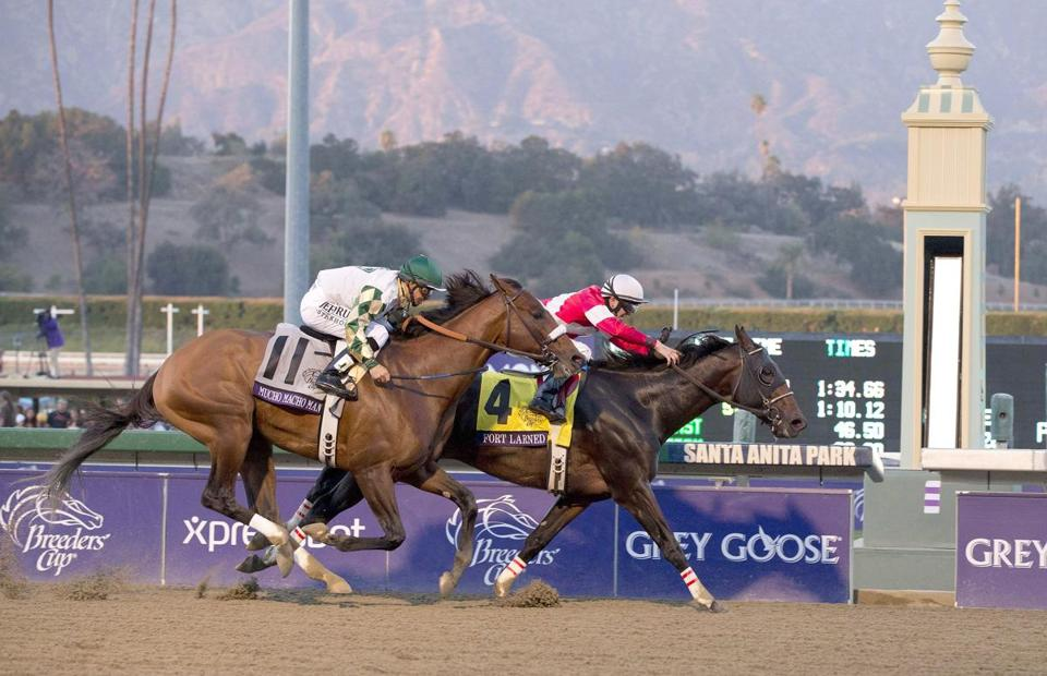 Fort Larned, with Brian Hernandez Jr. aboard, holds off Mucho Macho Man to win the Breeders' Cup Classic