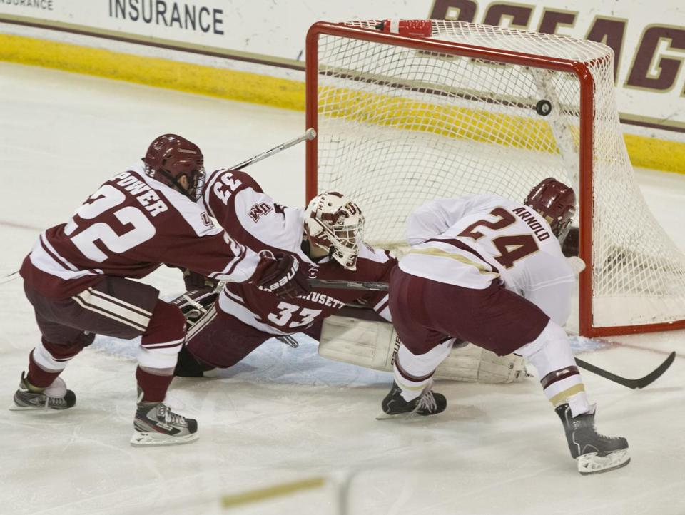 BC's Bill Arnold goes top shelf for a goal, beating UMass' Troy Power and goalie Kevin Boyle during the first period.
