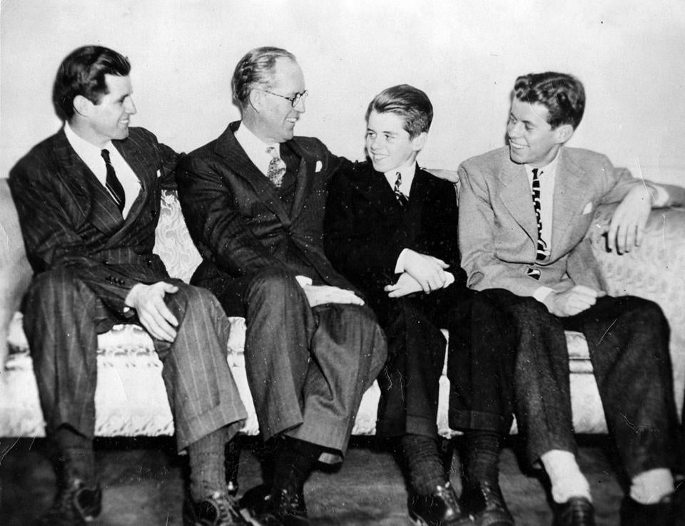 Joseph P. Kennedy, Sr., (second from left) with his sons (from left) Joseph P. Kennedy, Jr., Robert F. Kennedy, and John F. Kennedy in 1938.