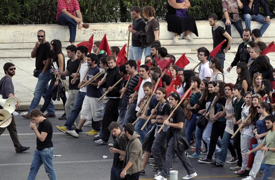 More than 35,000 people marched Tuesday in two separate demonstrations in Athens organized by labor unions protesting against new austerity measures.