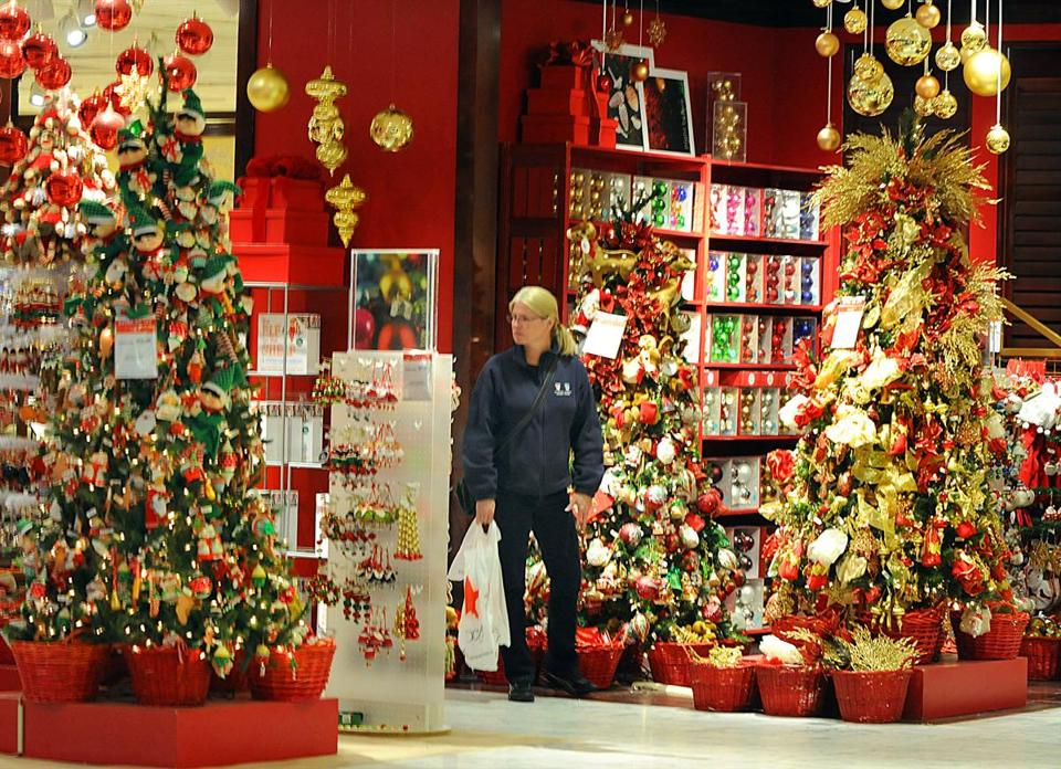 At the South Shore Plaza in Braintree, a shopper looked at Macy's Christmas display. Retailers anticipate greater holiday sales this year.