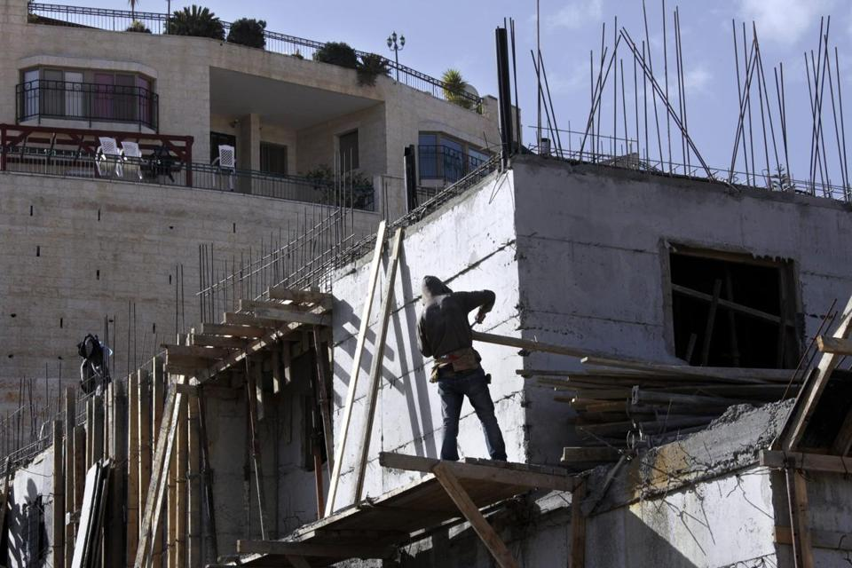 Israel plans to proceed with construction of homes in East Jerusalem. A Palestinian official condemned the action.