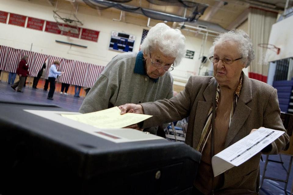 Edna Flanagan (left), 96, and Esther Theodore, 88, cast their ballots in Manchester.