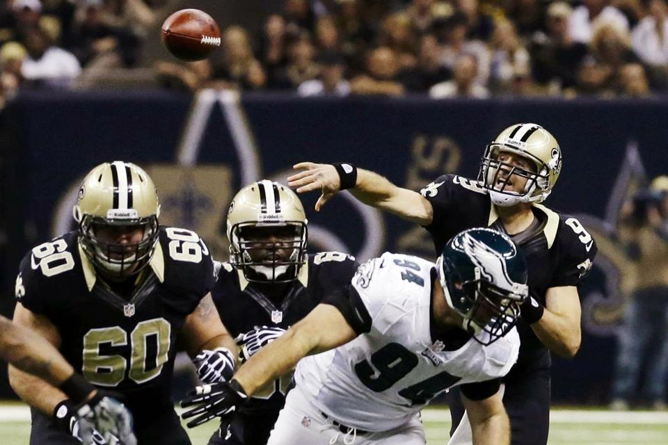Drew Brees, delivering a first-half completion, threw for two touchdowns to lead the Saints to a much-needed win.