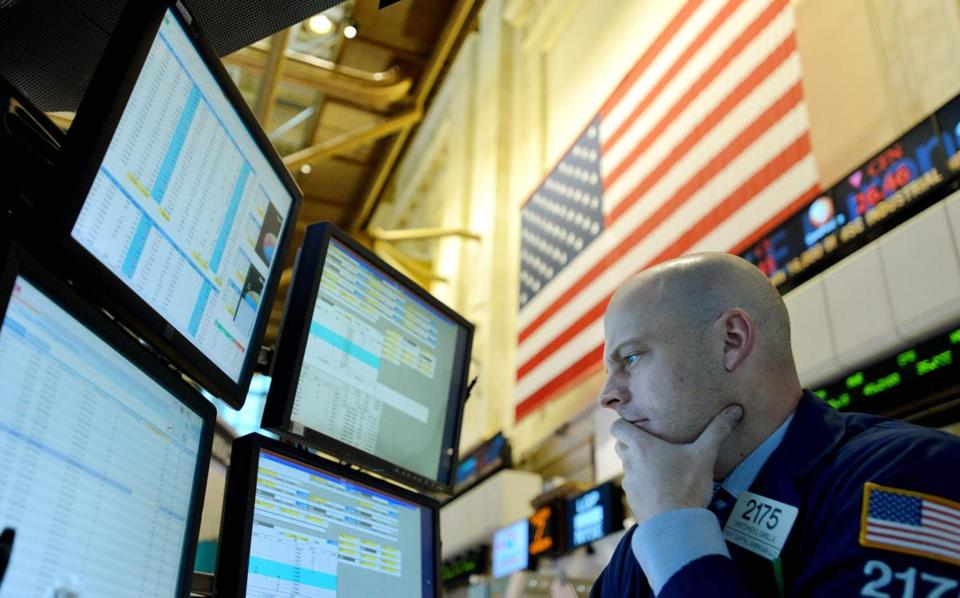 A trader worked on the floor of the New York Stock Exchange as the Dow Jones Industrials lost over 300 points.
