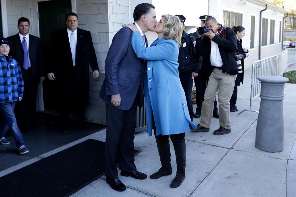 Returning to Massachusetts, Mitt Romney got a kiss from his wife, Ann, after they voted in his hometown of Belmont Tuesday.