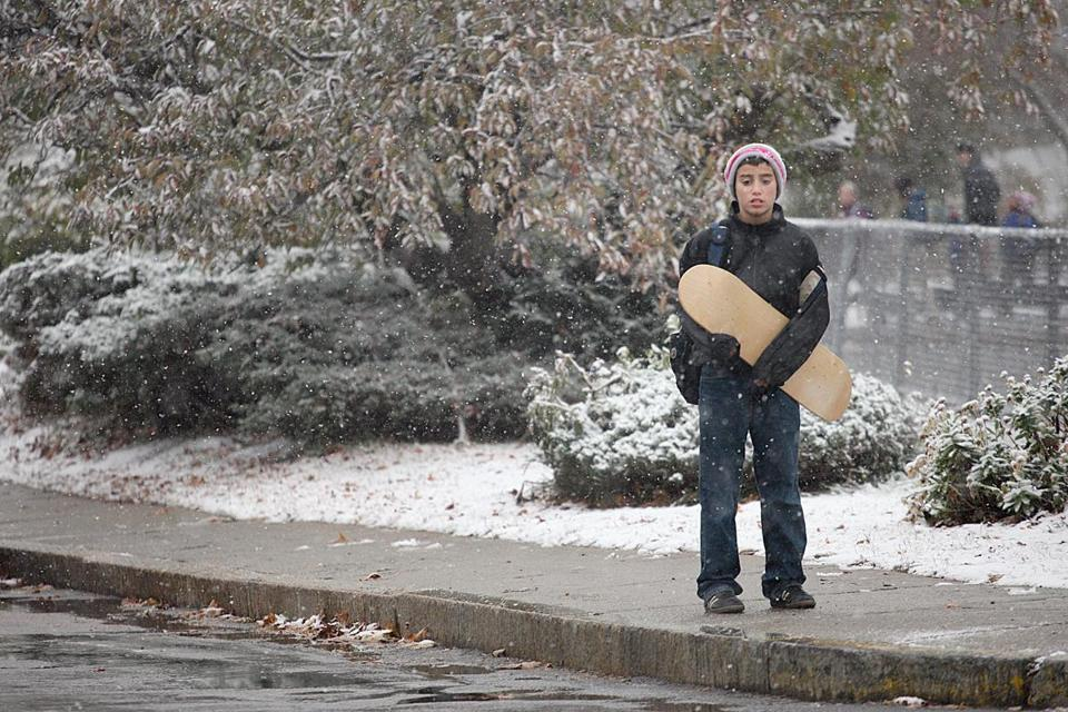 Joey Cohen, 11, waited to be picked up Wednesday outside Angier Elementary School in Newton.