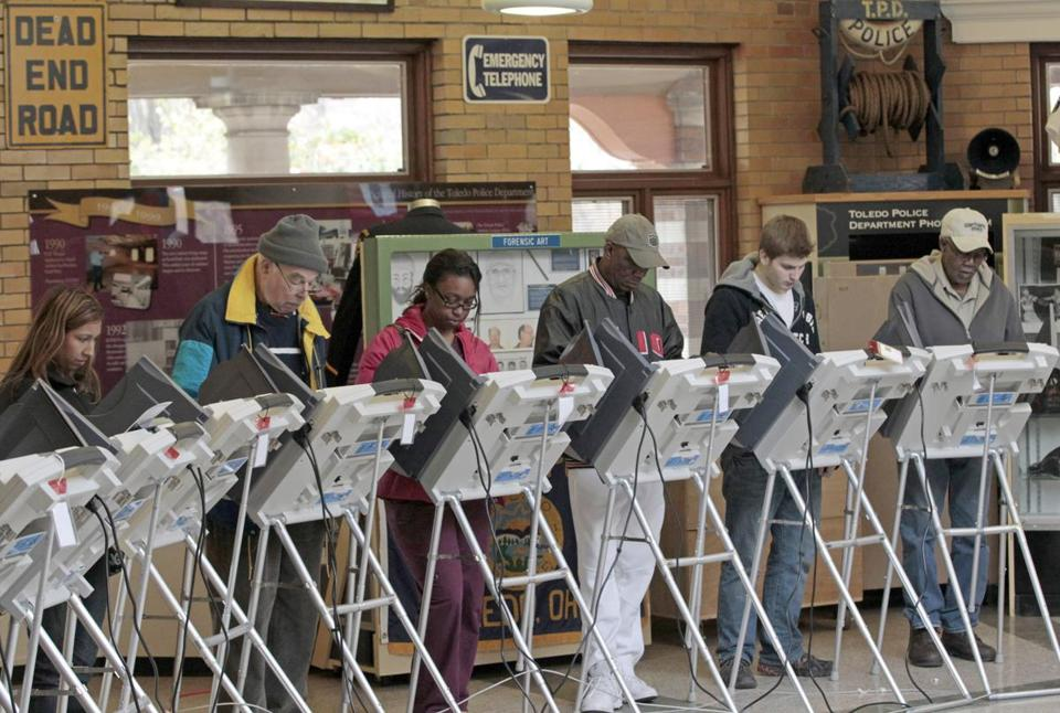 Voters cast their ballots at the Toledo Police Museum. Polls in Ohio closed at 7:30 p.m. The candidates have battled it out for the state's 18 electoral votes.