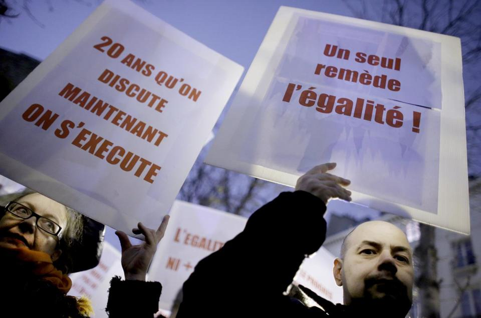 "Supporters of the bill held placards reading: ""20 years of discussion, now is the time to act"" Wednesday in Paris."