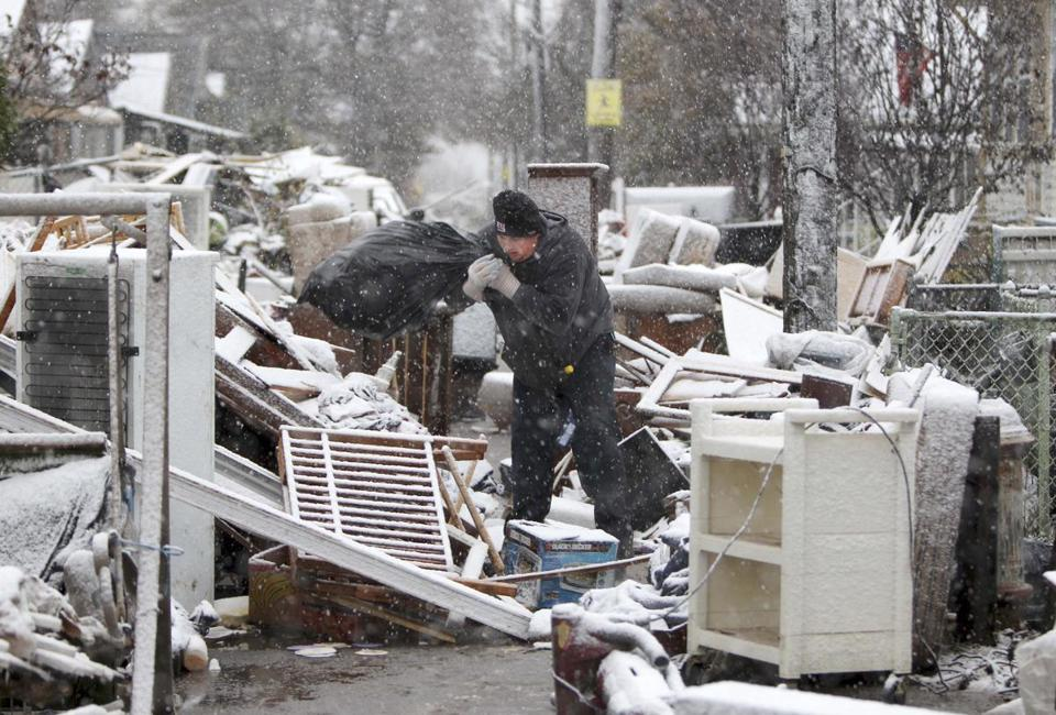 Snow fell in the New Dorp section of Staten Island, a neighborhood still reeling from the effects of Hurricane Sandy.