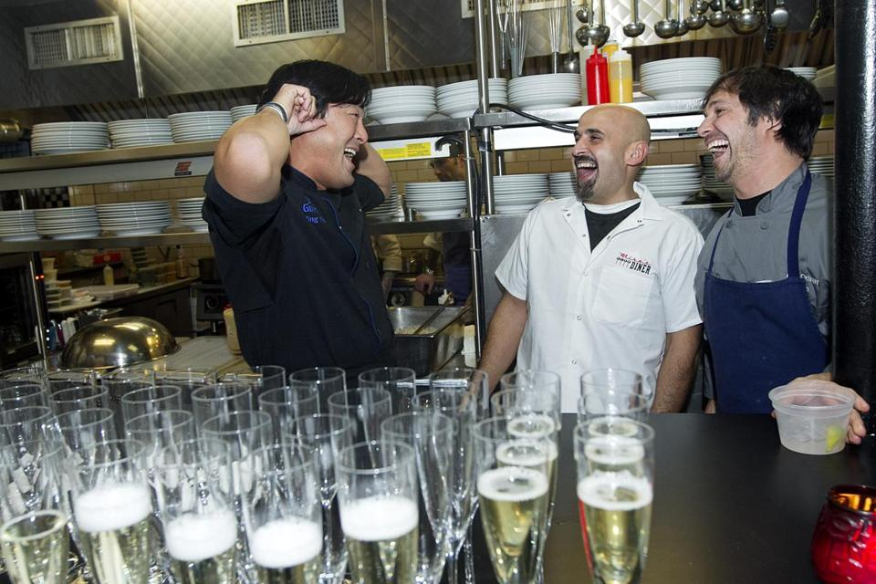From left: Ming Tsai, Jay Hajj, and Ken Oringer share a laugh during the benefit meal on Wednesday.