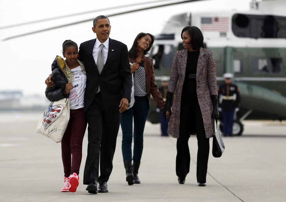 President Obama, his wife, Michelle, and daughters Sasha and Malia headed to Air Force One in Chicago on Wednesday.