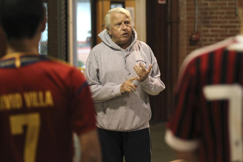 Don Brock, boys soccer coach from Needham High School, talked to his team during practice at the Pollard Middle School gym.