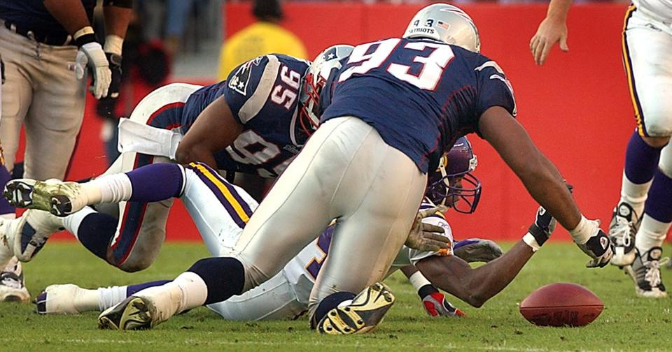Roman Phifer (95) and Richard Seymour (93) combined to force and then recover this fumble by Randy Moss.