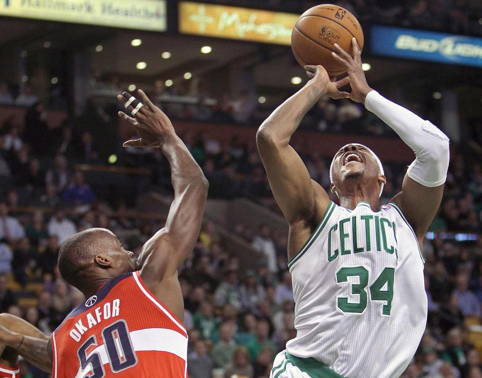 Paul Pierce went up against the Wizards' Emeka Okafor in the first quarter.