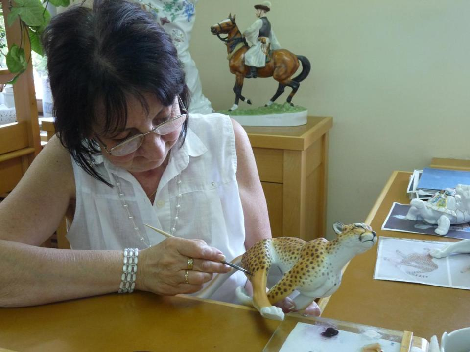 Every Herend hand-painted porcelain item is unique. This artist trained for three years and is painting free-hand.