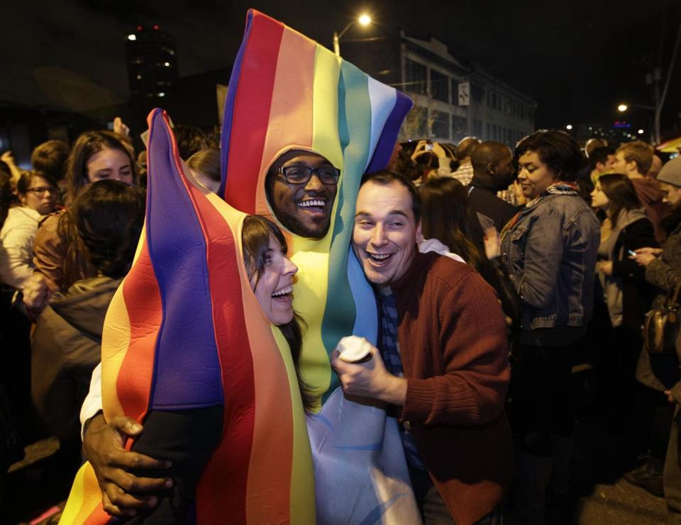 Supporters of Washington state's gay marriage law celebrate it passing Tuesday.
