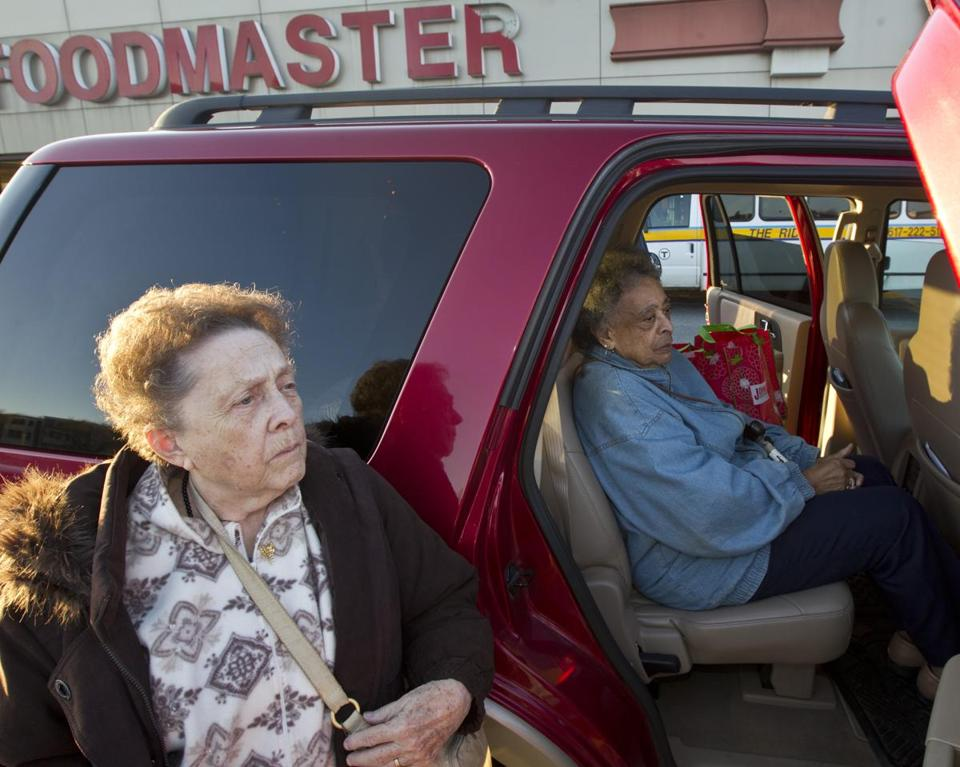Kay Olsen (left), 82, and Mary Holt, 88, shopped for groceries at Johnnie's Foodmaster in Charlestown before it closed last week.
